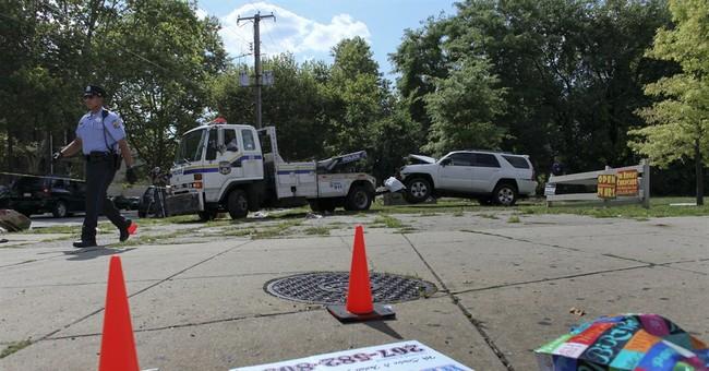 Carjacked SUV hits crowd, killing 3 young siblings