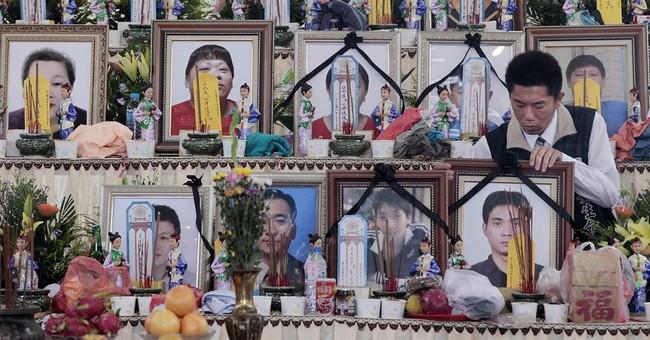 Taiwan plane survivor crawls out, phones dad