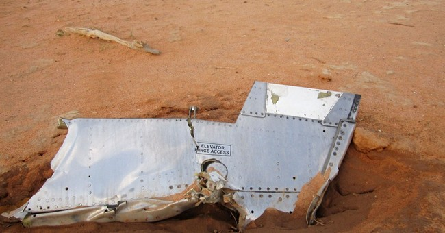 Air Algerie jet's black boxes to be sent to France