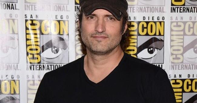 Alba reveals her 'Sin City' dark side at Comic-Con