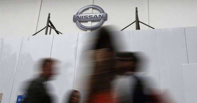 Nissan profit rises on strong sales, cheap yen