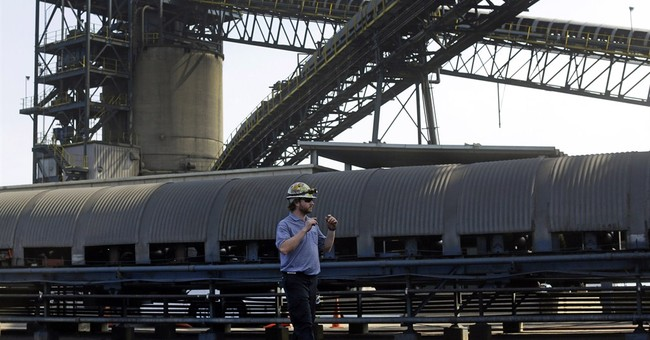 AP PHOTOS: Coal-exporting town fights rising seas