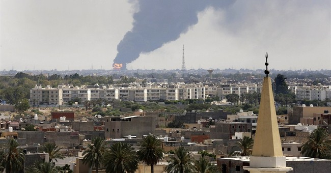 Militia gunfire in Libya capital as inferno rages