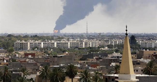 Militia gunfire in Libya capital as inferno rages