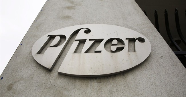 Pfizer's 2Q profit sinks 79 pct but tops forecasts
