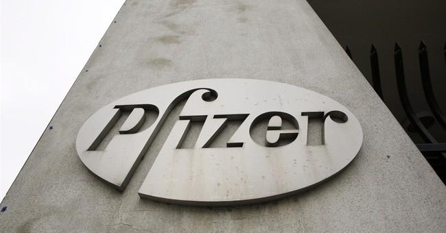 Pfizer's 2Q profit sinks 79 pct but tops forecasts