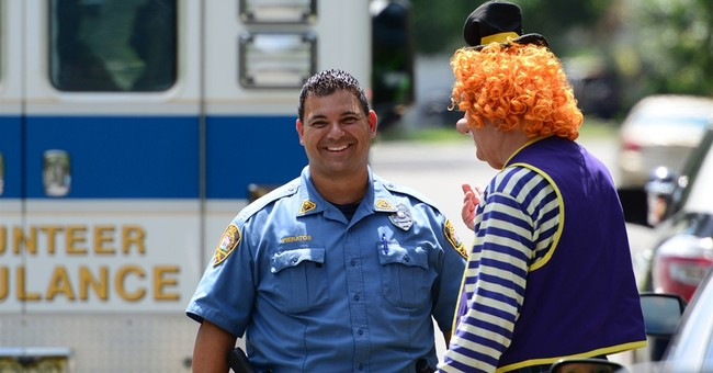 Clowns help fellow clown who crashed car into pole