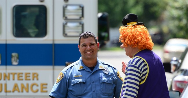 Clowns help fellow clown who crashed car into pole