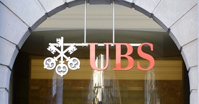 UBS sees profits rise, probed over trading system