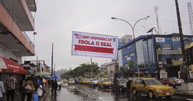 Top doctor dies from Ebola after treating dozens