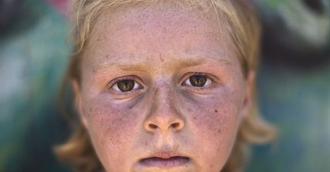 AP PHOTOS: Face of Syrian war seen in youngest
