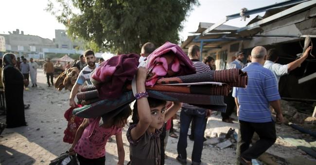 AP PHOTOS: At least 17 die in Gaza school attack