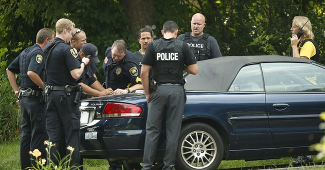 Suspect in Minnesota officer killing in custody