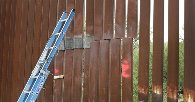 Rains, smugglers damage US-Mexico border fence