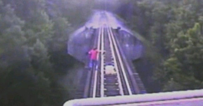 2 charged after Indiana rail bridge close call