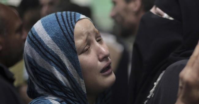 Deadly Israeli strikes hit UN school, market area