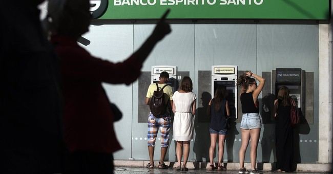 Ailing Portuguese bank's shares sink after losses