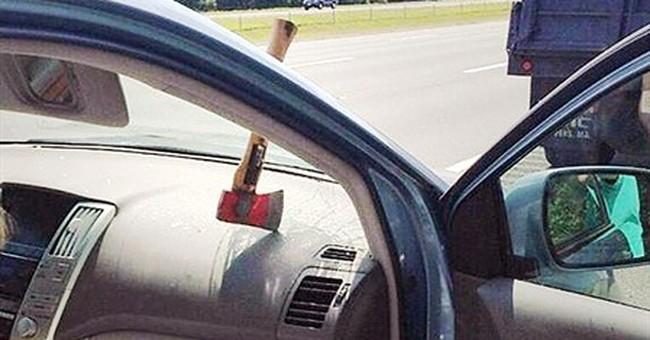 Ax crashes through car windshield on highway