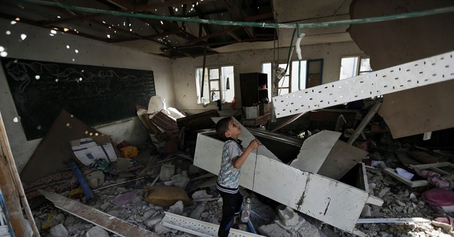 AP PHOTOS: At least 17 die in Gaza school attack