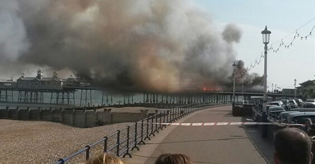 Historic English pier engulfed in flames