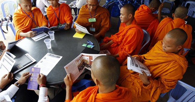AP PHOTOS: Cambodians attend Khmer Rouge tribunal