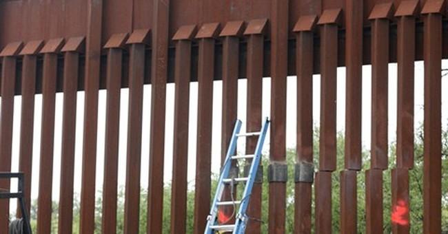 Rains, smugglers damage US-Mexico border fence