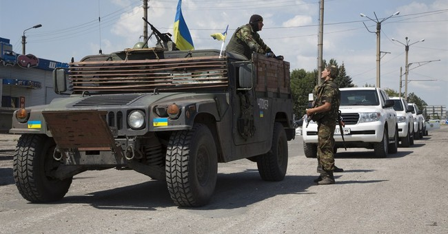 Investigators reach Ukraine jet wreckage site