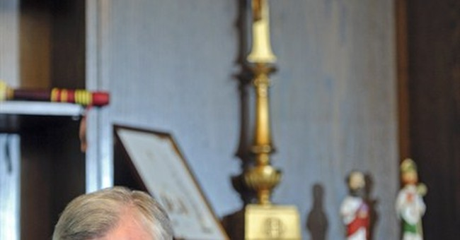 Archbishop says he didn't mismanage abuse scandal