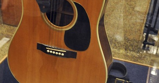 Elvis' guitar donor says he is rightful owner
