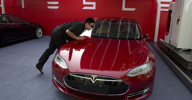 Tesla posts 2Q loss, prepares Nevada factory site