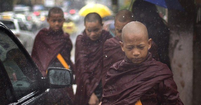 Image of Asia: Collecting alms in the rain