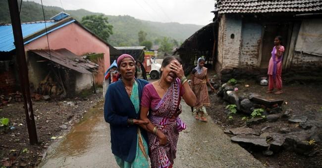 Mud, rain hamper landslide rescue in India