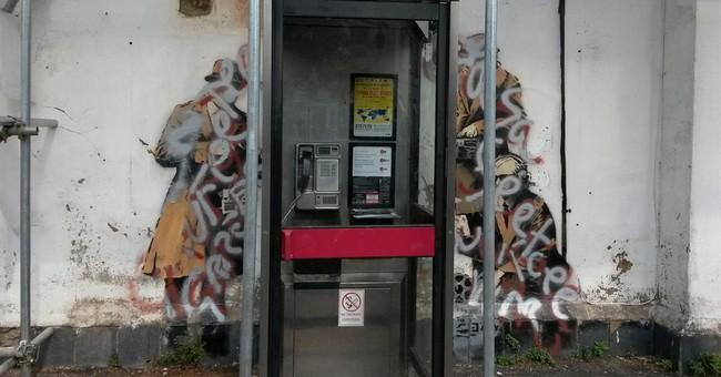 Banksy's 'Spy Booth' artwork defaced