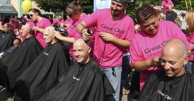 Ohio theme park says it topped shaved-heads record