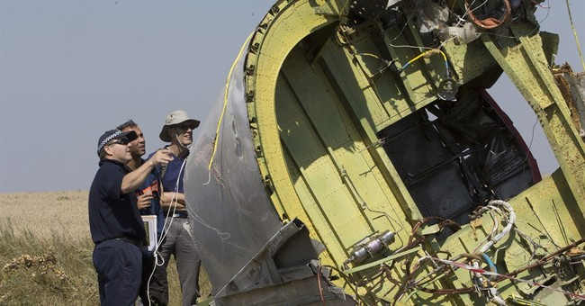 Ukraine: Body parts retrieved at jet crash site