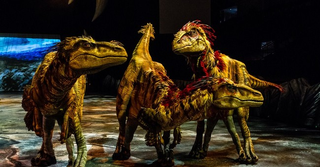 Updated dinosaurs stalk America in arena show