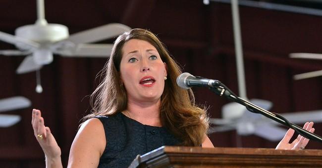 Hundreds cheer, jeer Kentucky's Senate candidates