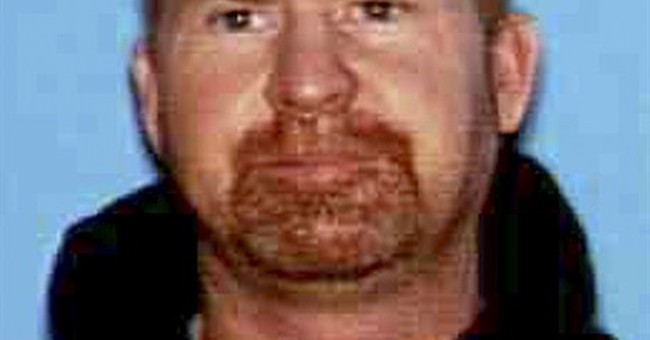 Remains found of man sought in family's slayings