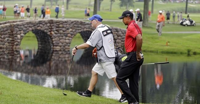 Back pain knocks Woods out of Bridgestone