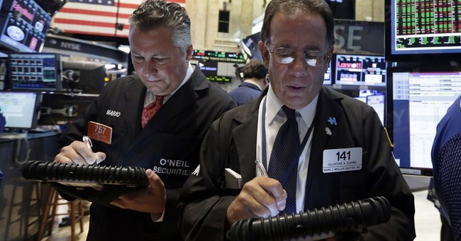 Stocks give up an early gain, mixed at midday