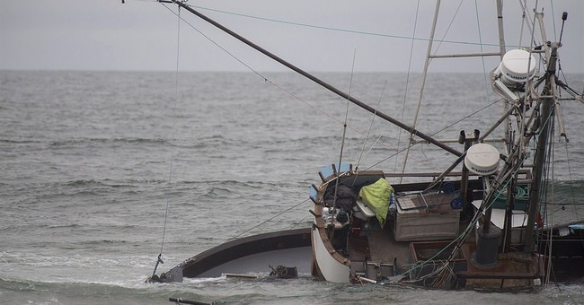 Crews suspend search for man near grounded boat