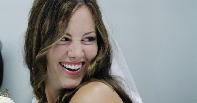 Newlyweds take vows at hockey rink