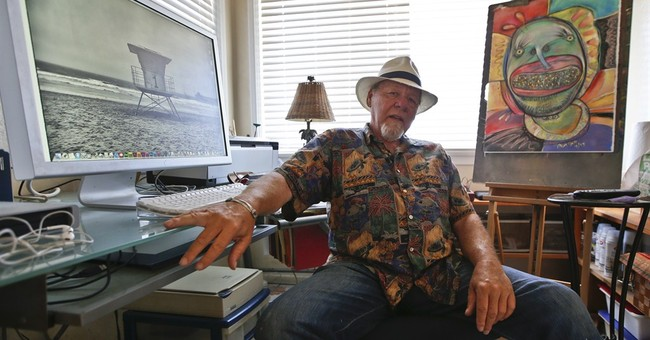 Ailing 'Ghostbusters' artist gives bird to cancer