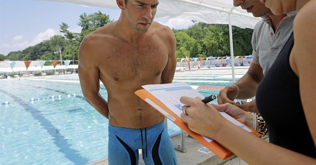 APNewsBreak: Phelps signs with new suit company