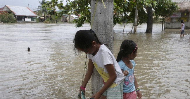 Image of Asia: Fetching water in a flood zone