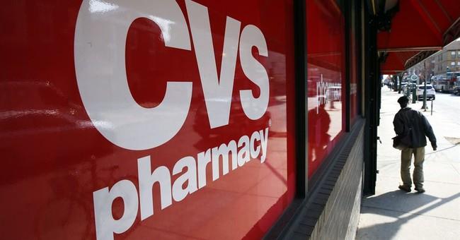 CVS 2Q profit climbs 11 percent, forecast rises