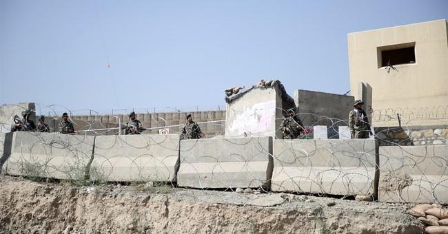 Afghan official: General's killer hid in bathroom