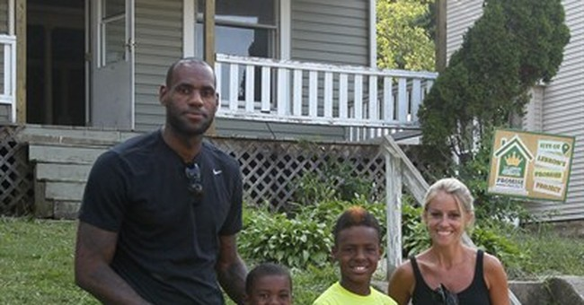 LeBron, sons pitch in on Akron home rehab