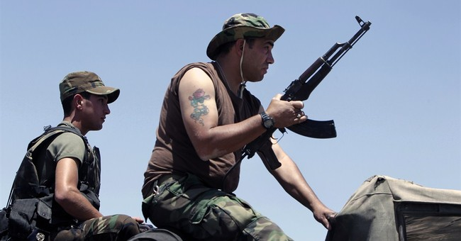 Some Syrian militants pull out of Lebanese town
