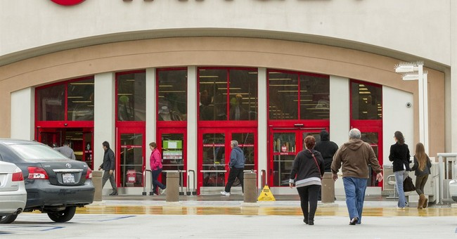 Target lowers forecast, estimates breach costs